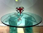 Glass top table with heart sculpture
